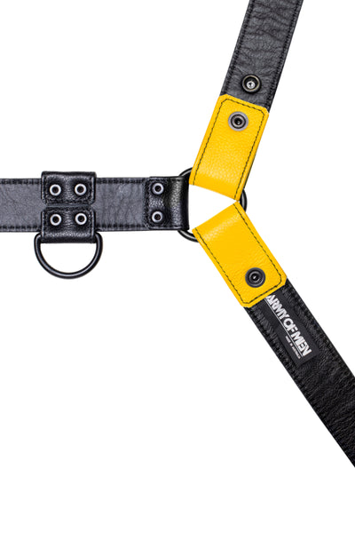 Yellow leather bulldog harness with black hardware. Lining.