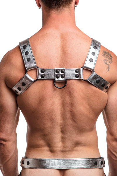 Model wearing metallic silver leather bulldog harness