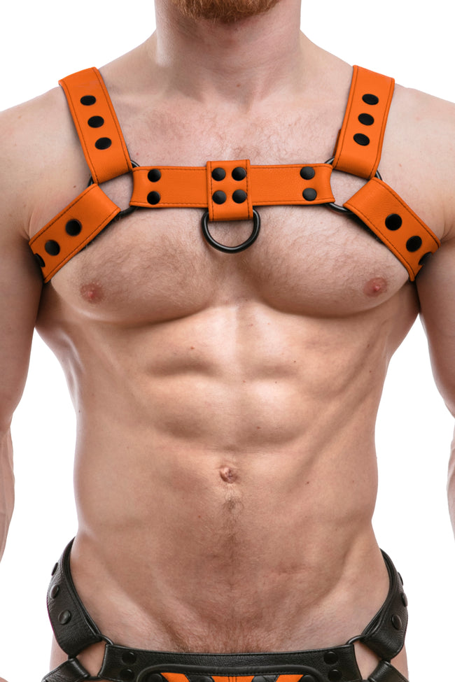 Model wearing full orange leather bulldog harness. Front