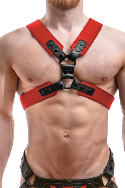 Model wearing a red leather commander harness