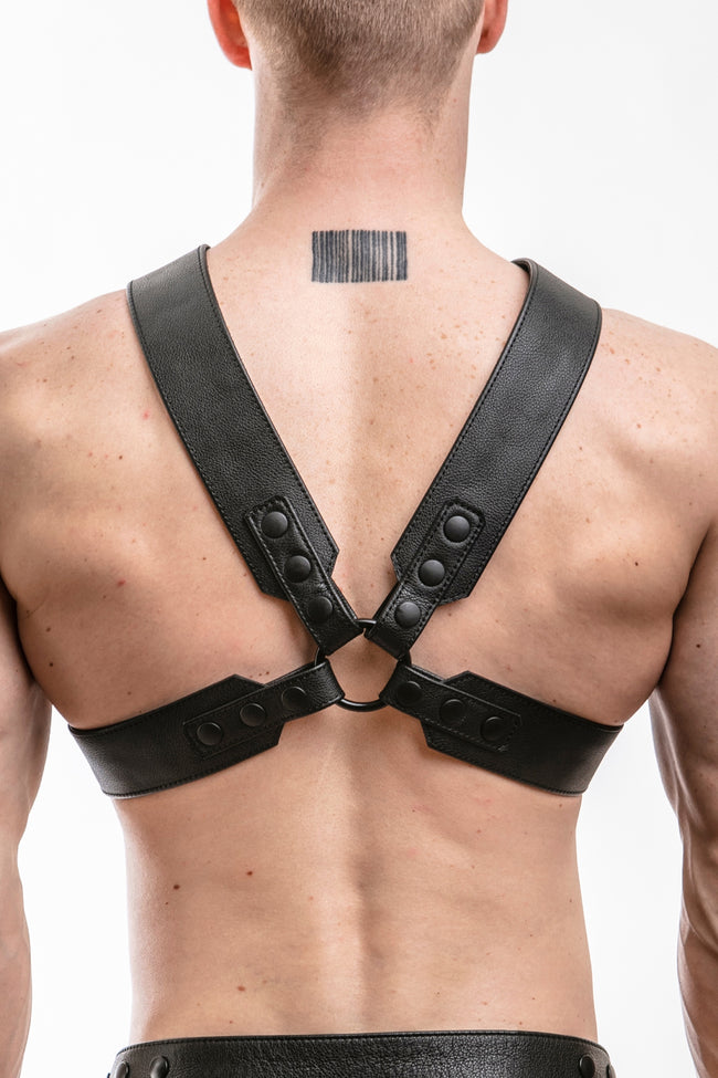 Model wearing black leather sergeant x harness