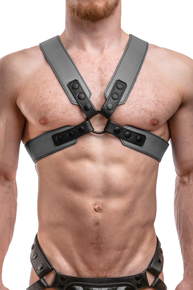Model wearing a grey leather sergeant harness