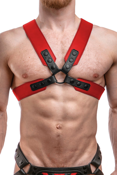 Model wearing a red leather sergeant harness