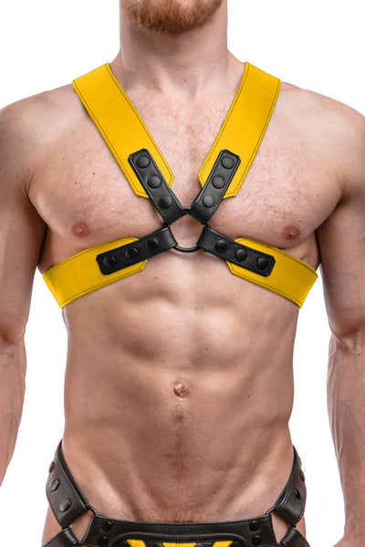 Model wearing a yellow leather sergeant harness