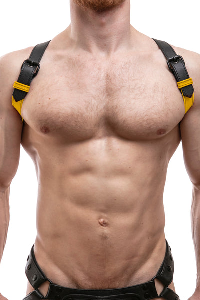 Model wearing yellow leather shoulder buckle harness front