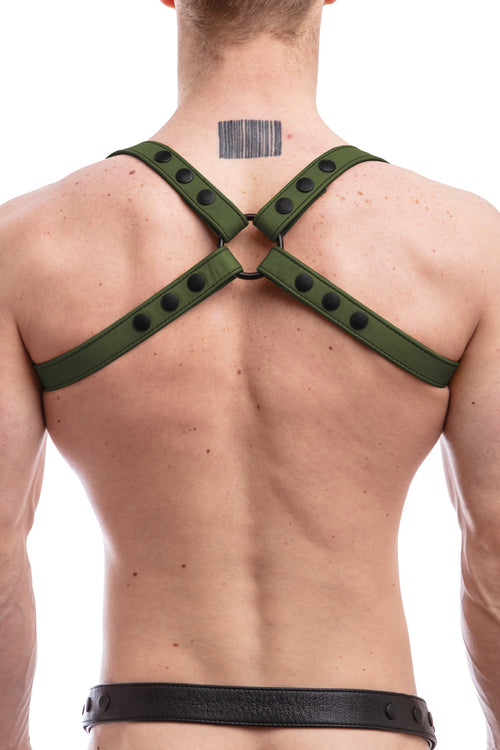 Model wearing army green leather shoulder harness back