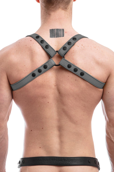 Model wearing grey leather shoulder harness back
