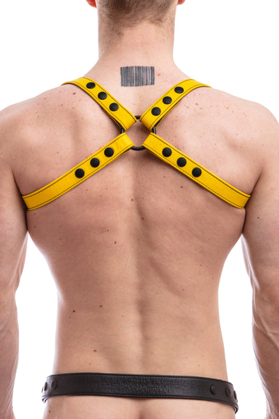 Model wearing yellow leather shoulder harness back