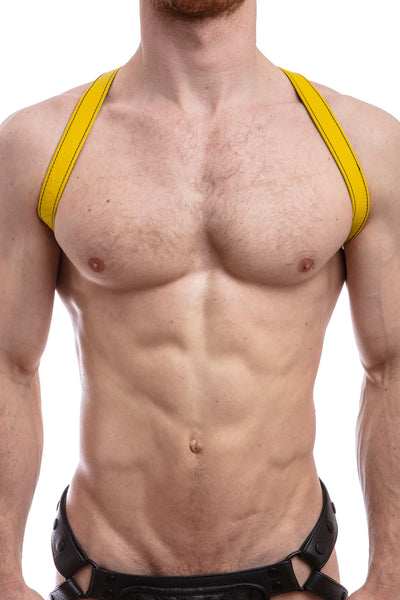 Model wearing yellow leather shoulder harness front