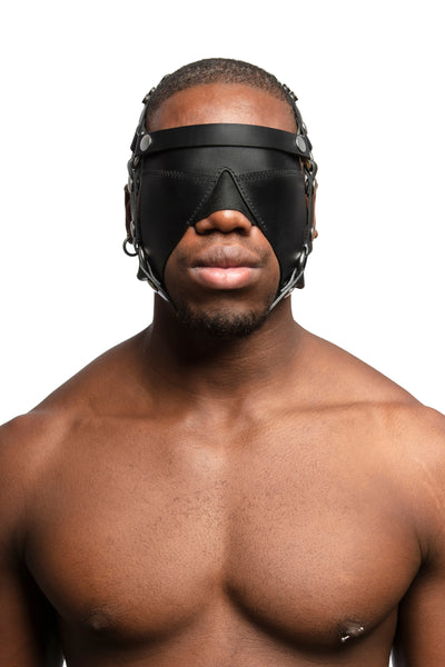 Model wearing black leather head harness and blinder with stainless steel hardware. Front view.