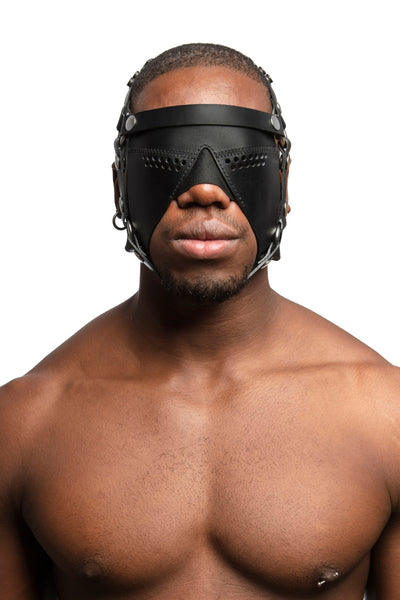 Model wearing black leather head harness and partial blinder with stainless steel hardware. Front view.