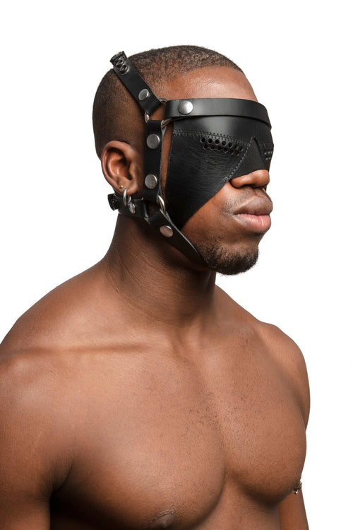 Model wearing black leather head harness and partial blinder with stainless steel hardware. Three quarter view.