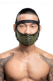 Model wearing black leather head harness and army green muzzle front