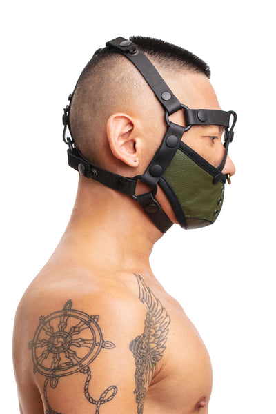 Model wearing black leather head harness and army green muzzle side