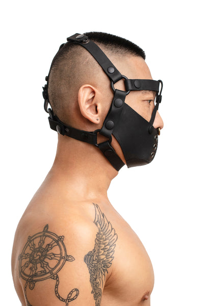 Model wearing black leather head harness and muzzle side