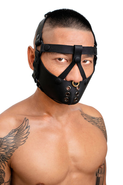 Model wearing black leather head harness and muzzle front