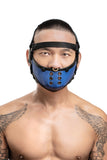 Model wearing black leather head harness and blue muzzle front