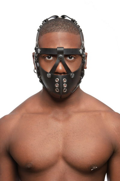 Model wearing black leather head harness and muzzle with stainless steel hardware, front