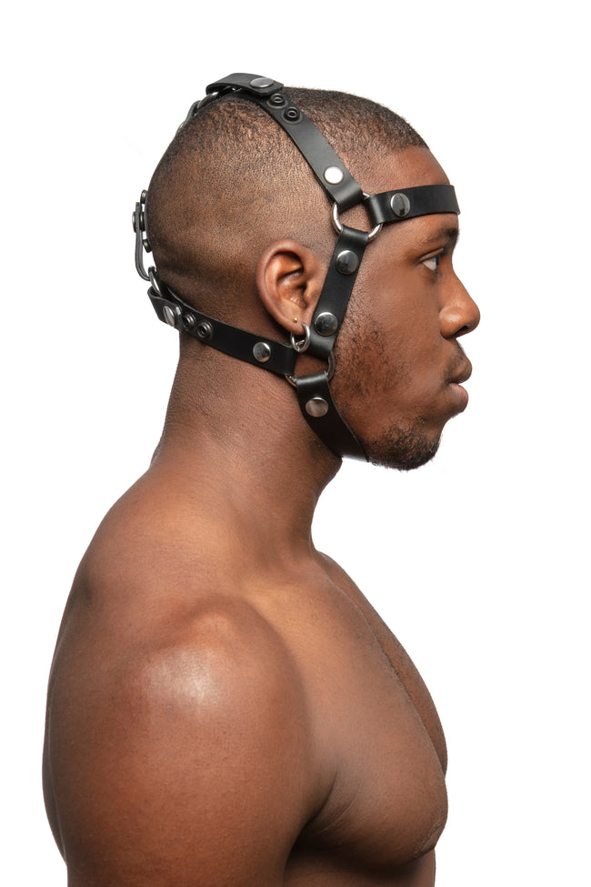 Model wearing black leather head harness with stainless steel hardware, side