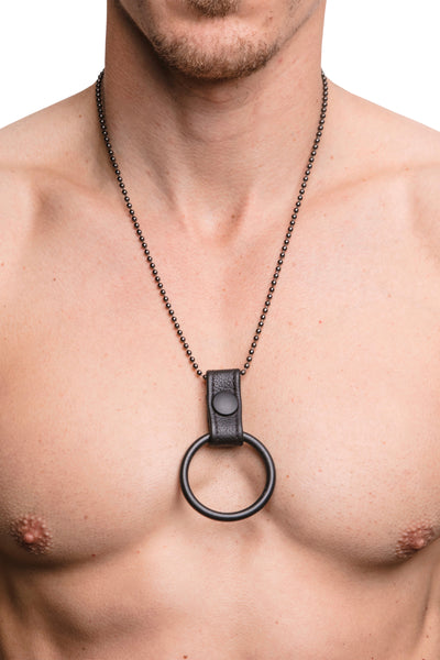 Model wearing cockring chain