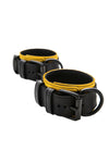 Black and yellow leather ankle restraints