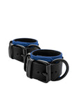 Black and blue leather wrist restraints
