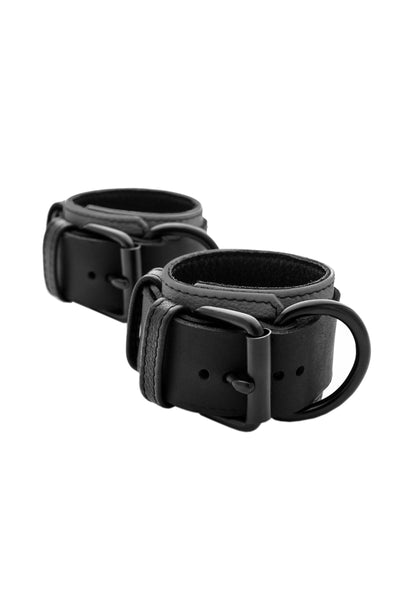 Grey and black leather wrist restraints