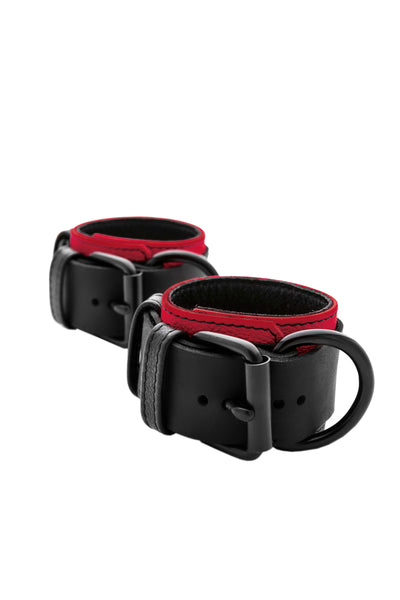 Red and black leather wrist restraints