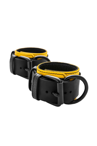 Yellow and black leather wrist restraints