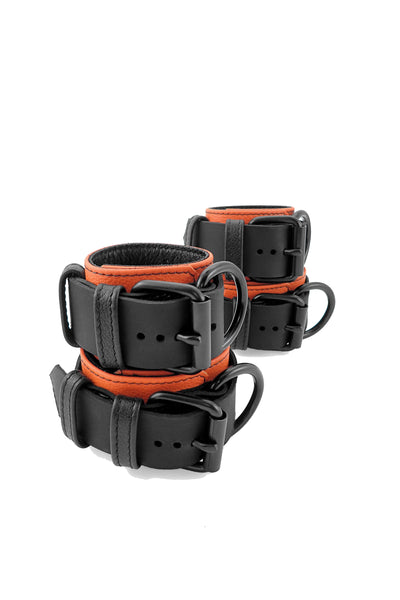 Orange and black leather wrist and ankle restraints set