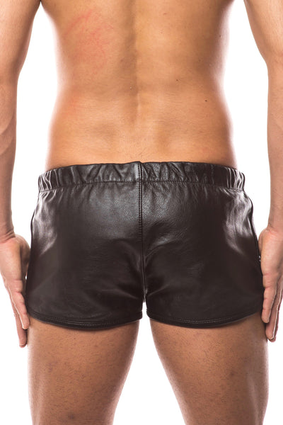 Model wearing black leather racer shorts