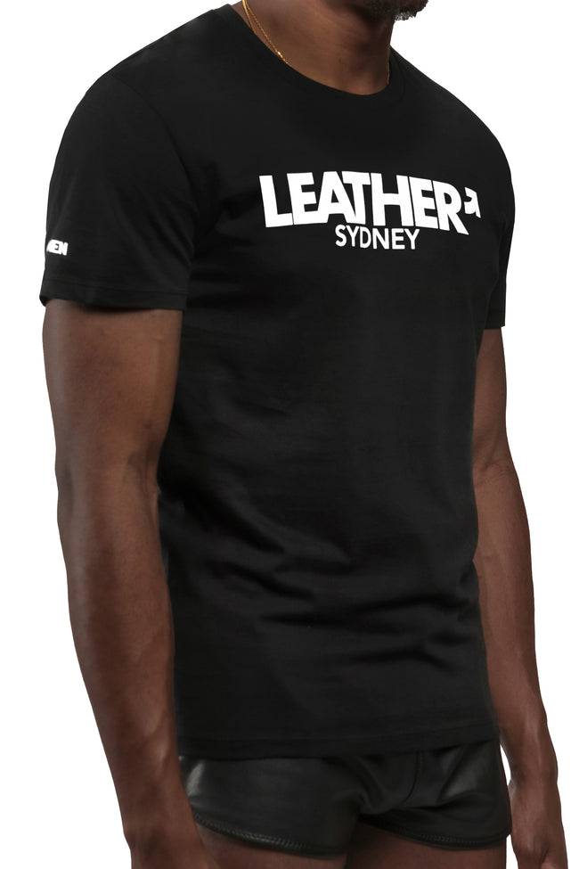 "Model wearing black ""LEATHER SYDNEY"" t-shirt. Three quarter view."