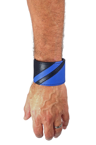 Model wearing a black leather wristband with blue leather chevron detailing