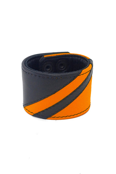 Black leather wristband with orange leather chevron detailing