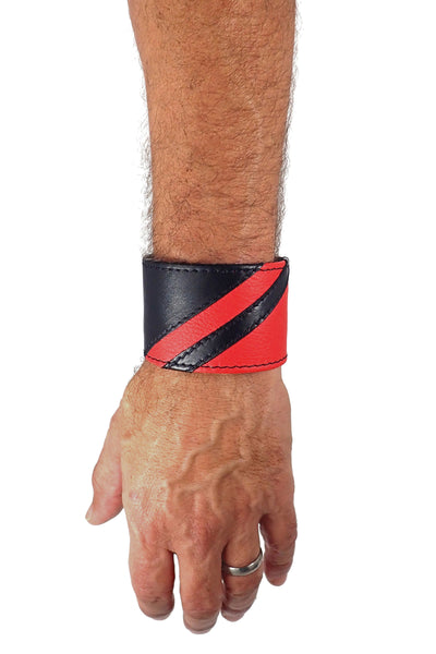 Model wearing a black leather wristband with red leather chevron detailing