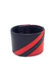 Black leather wristband with red leather chevron detailing