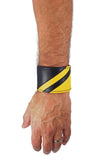 Model wearing a black leather wristband with yellow leather chevron detailing