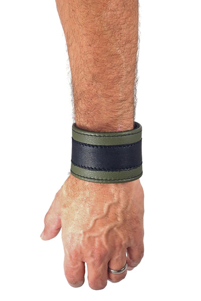 "Model wearing a 2"" wide leather wristband with army green leather racer stripe detailing"