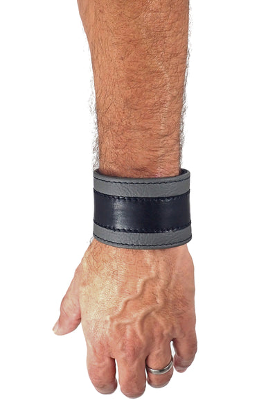 "Model wearing a 2"" wide leather wristband with grey leather racer stripe detailing"