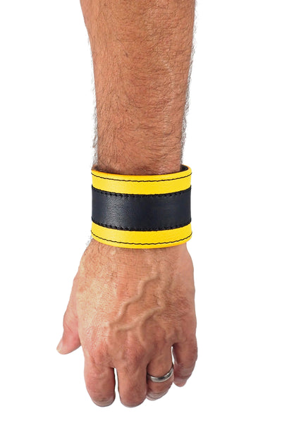 "Model wearing a 2"" wide leather wristband with yellow leather racer stripe detailing"