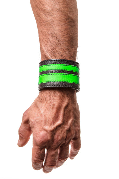 Model wearing a fluro green leather stripe wristband