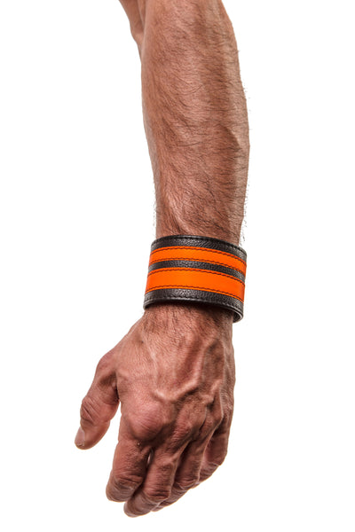 Model wearing a fluro orange leather stripe wristband