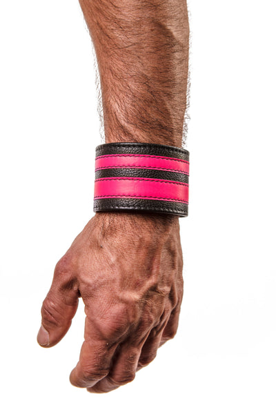 Model wearing a fluro pink leather stripe wristband