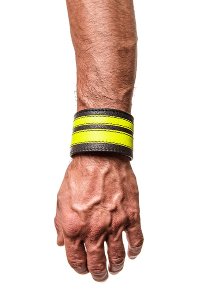 Model wearing a fluro yellow leather stripe wristband