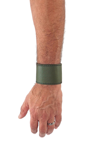 "Model wearing an army green leather 2"" wide leather wristband"