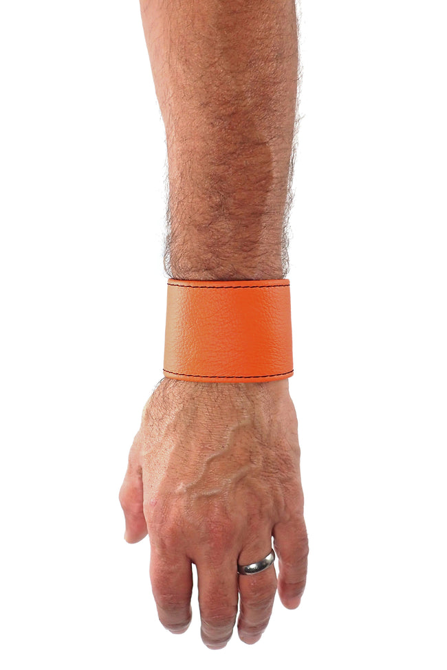 "Model wearing an orange leather 2"" wide leather wristband"