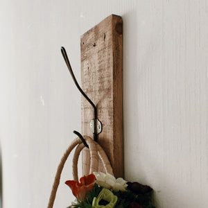 Holin coat hanger made from recycled wood