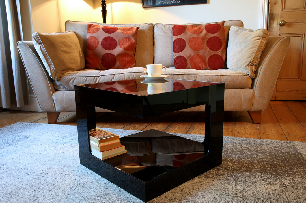 Black square acrylic coffee table