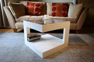 white acrylic coffee table