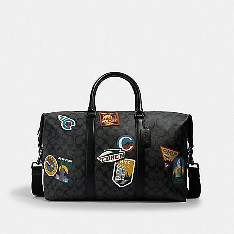 Coach Trekker Bag In Signature Charcoal Black With Travel Patches